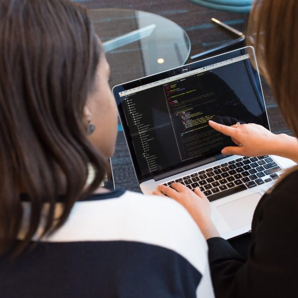 two-women-looking-at-the-code-at-laptop-1181263